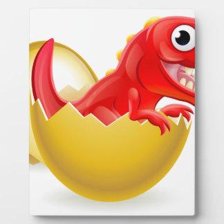 Cartoon Dinosaur Hatching from Egg Plaque
