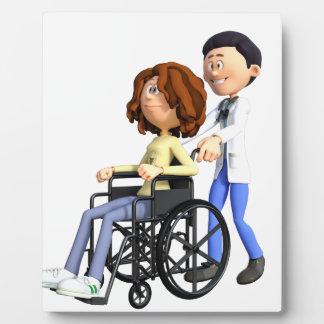 Cartoon Doctor Wheeling Patient In Wheelchair Plaque