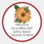 Cartoon Honey Bees Meeting on Orange Flower Round Sticker