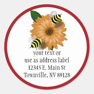 Cartoon Honey Bees Meeting on Orange Flower Classic Round Sticker