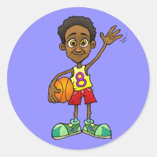 Cartoon illustration of a boy holding a ball. classic round sticker