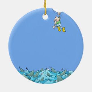 Cartoon illustration of a man hanging over sharks. ceramic ornament
