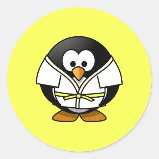 Cartoon Judo Penguin Yellow Background Classic Round Sticker
