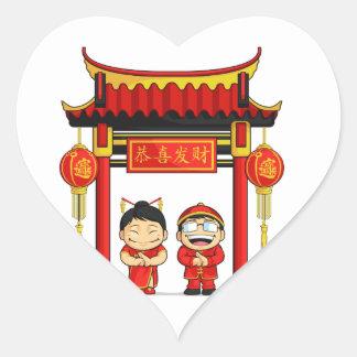 Cartoon of Boy & Girl Greeting Chinese New Year Heart Sticker