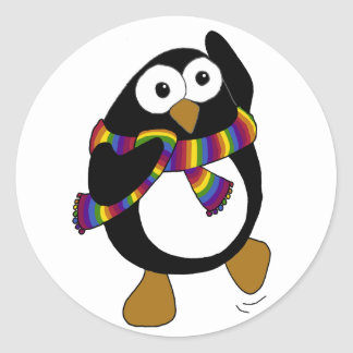 Cartoon penguin wearing a colorful rainbow scarf. classic round sticker