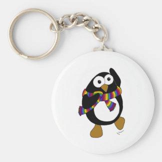 Cartoon penguin wearing a colorful rainbow scarf. keychain