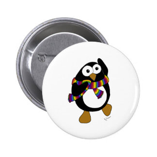 Cartoon penguin wearing a colorful rainbow scarf. pinback button