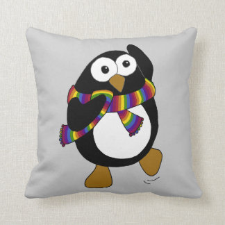 Cartoon penguin wearing a colorful rainbow scarf. throw pillow