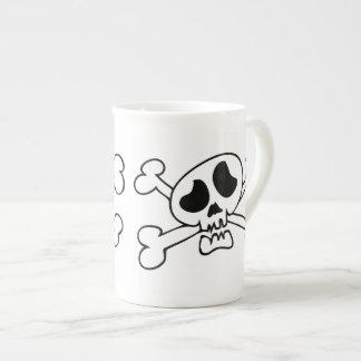 Cartoon skull with crossing bones tea cup