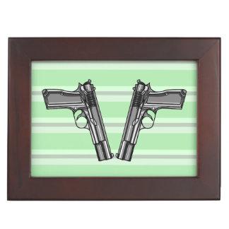 Cartoon style illustration of two handguns memory box
