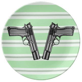 Cartoon style illustration of two handguns porcelain plate