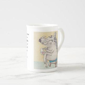 Cartoon warthog working on embroidery hoop tea cup