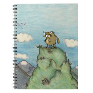Cartoon yak drawing on mountain top notebook