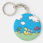 Cartoon yellow snail and mushrooms keychain