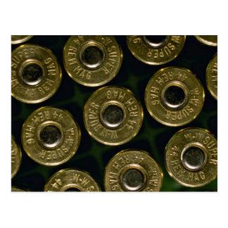 Cartridges, .44 magnums in carrier, detail of cap postcard