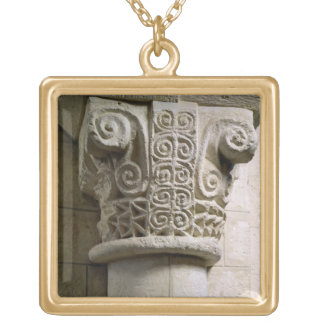 Carved column decorated with croziers and spirals pendants