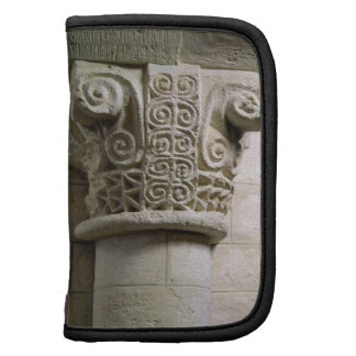 Carved column decorated with croziers and spirals planners