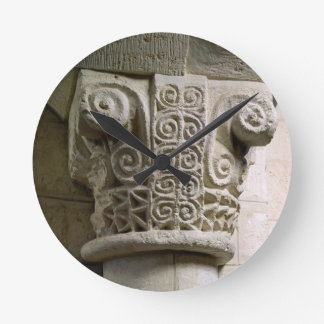 Carved column decorated with croziers and spirals round clock
