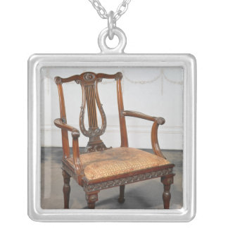 Carved lyre-back chair, supplied by silver plated necklace