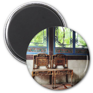 Carved patterns on wooden chairs and windows magnet