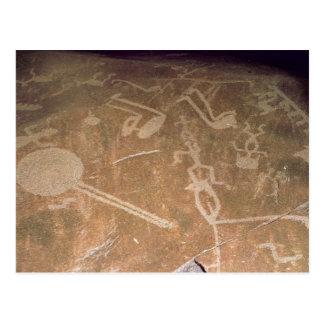 Carved petroglyph depicting figures postcard