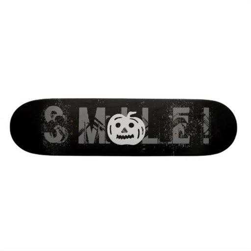 Carved Pumpkin Silhouette with Teeth. Skateboard