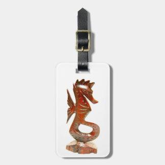 carved wood seahorse tag