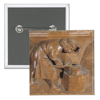 Carving depicting a coppersmith 2 inch square button