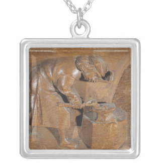 Carving depicting a coppersmith silver plated necklace