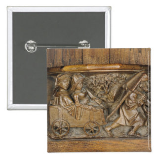 Carving depicting a couple in cart pulled by a 2 inch square button