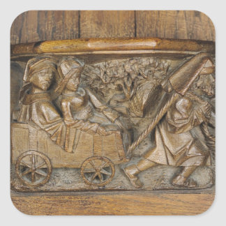 Carving depicting a couple in cart pulled by a square sticker