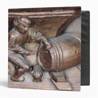Carving depicting a man putting a tap on barrel vinyl binders