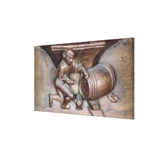 Carving depicting a man putting a tap on barrel canvas print