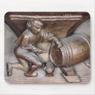 Carving depicting a man putting a tap on barrel mouse pad