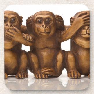 Carving of three wooden monkeys beverage coaster