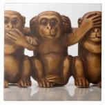Carving of three wooden monkeys ceramic tiles