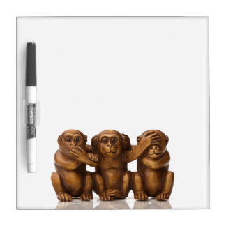Carving of three wooden monkeys dry erase board