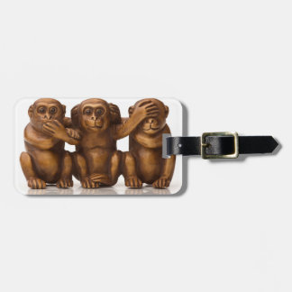 Carving of three wooden monkeys travel bag tag
