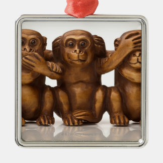 Carving of three wooden monkeys metal ornament