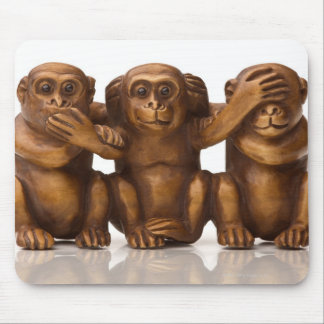 Carving of three wooden monkeys mouse pad