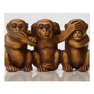 Carving of three wooden monkeys poster
