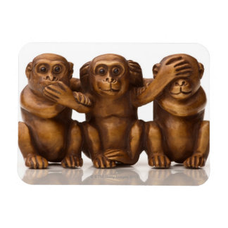 Carving of three wooden monkeys rectangular photo magnet