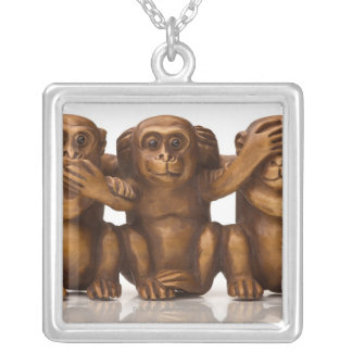 Carving of three wooden monkeys silver plated necklace