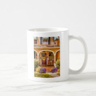 Casa - abuela que visita taza de café