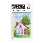 Casa colorida de la acuarela timbre postal