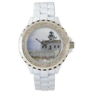 Casa con la luz reloj de mano