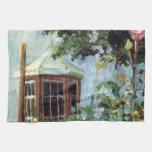 Casa con una ventana salediza en el jardín toallas de cocina