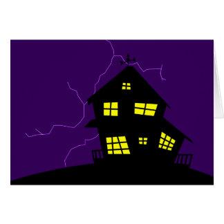 Casa de la colina de la silueta tarjeton