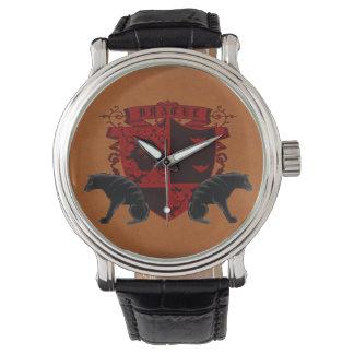 Casa de los Hellhounds del reloj del escudo de la