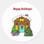 Casa de pan de jengibre del navidad y buenas etiquetas redondas